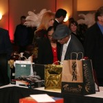 The Patels Bid on Silent Auction Packages HATC Casino Night